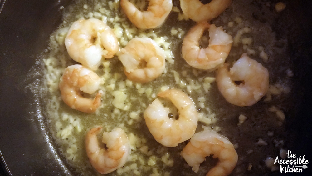 Shrimp cooking in butter garlic and oil