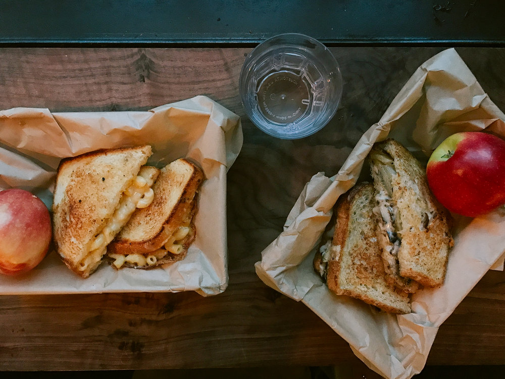 Left: Mac n Cheese Grilled Cheese. Right: Mushroom Gruyère Grilled Cheese