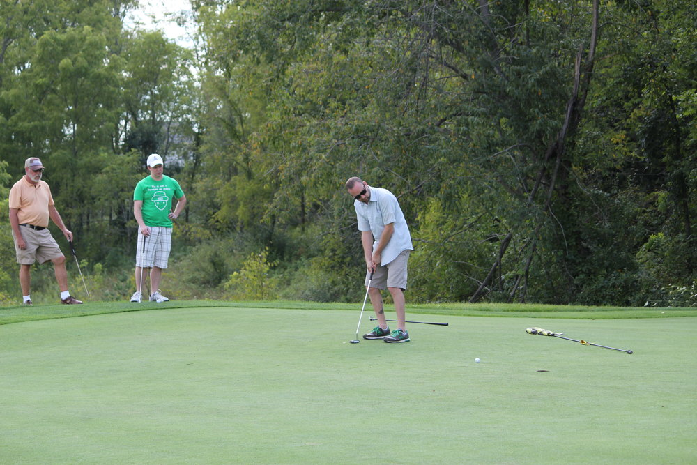 IMG_2226 John Brunette putting FFO Golf Outing 2015 copy.JPG