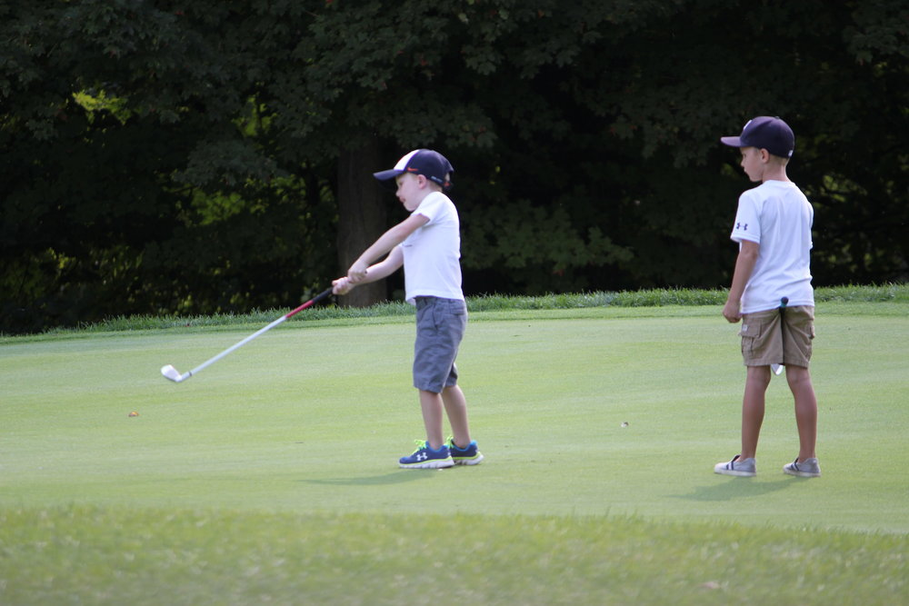 IMG_2272 Leyton and Caden putting FFO Golf Outing 2015 copy.JPG
