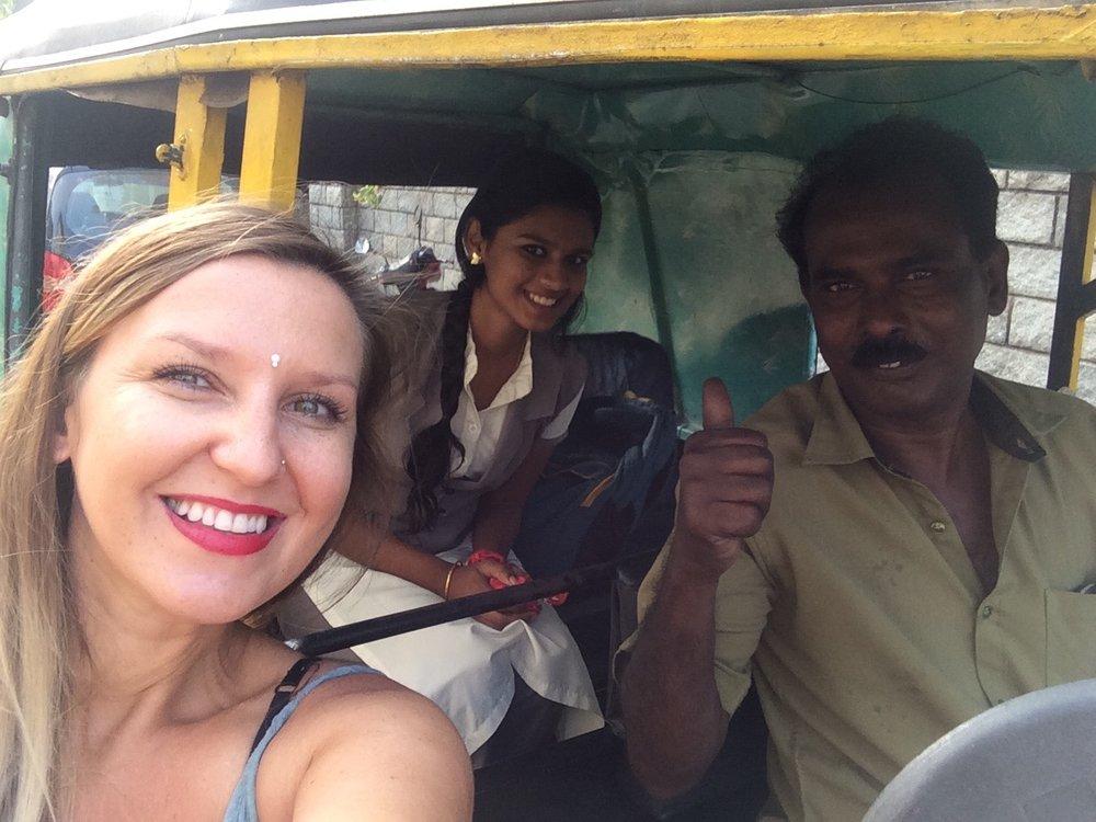 Marta taking a ride in a rickshaw