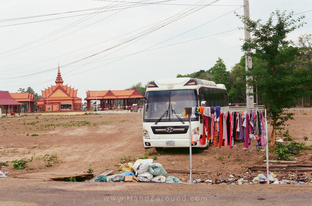 Laos and Cambodia border, on Cambodia's side with the orange building (the border) in the back. Interesting collection of stuff, isn't it?!