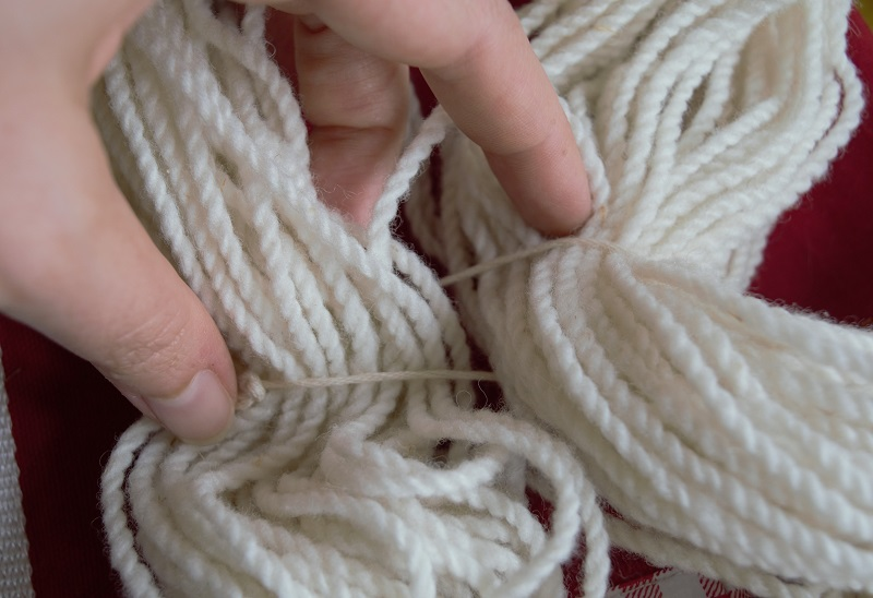 Loosely tie the yarn to keep it from knotting.