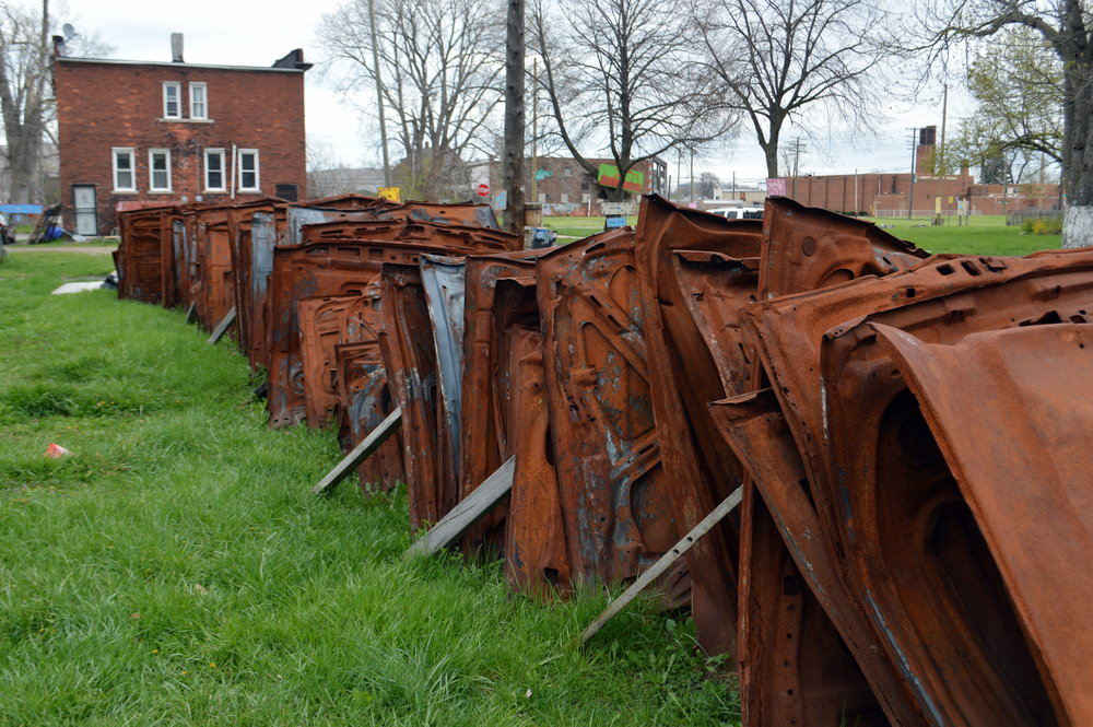 Remnants of detroit's past line up in rust in a neighborhood close to downtown, now a living art exhibit. photo: sharon letts
