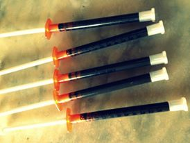 - Cannabis oil made with an alcohol reduction (recipes on the Apothecary page), in one gram syringes for measured dosing (not injectable). Though the original protocol for this strong oil was 60 grams in 90 days, with a step-up dosing to get used to the THC, we really don't know just how much you actually need to take to put various cancers and other ailments into remission. While protocols and formulations are currently being developed, this protocol stands as successful in the space.Photo: Sharon Letts