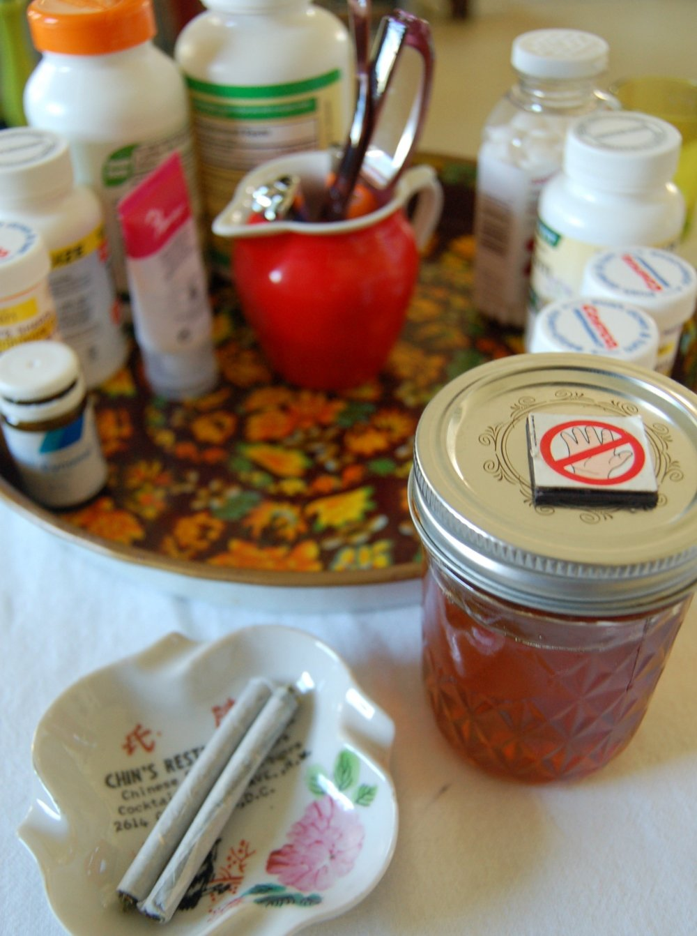 sharon's Past Prescription medication and supplement tray became her smoking and cannabis medication tray; now filled with tincture, salve, and smoking tools. Photo: Sharon Letts