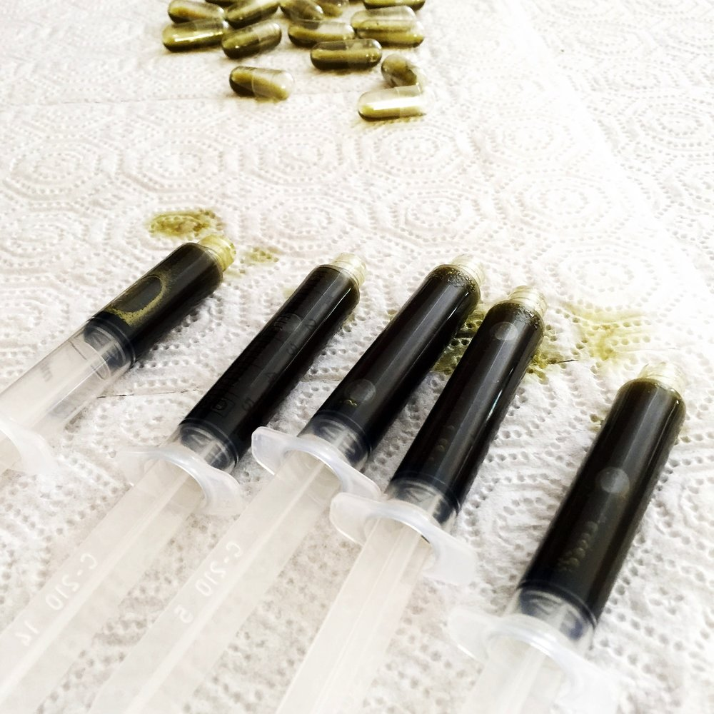 cannabis oil in syringes for easy dosing; caps for nightly use. photo: sharon letts