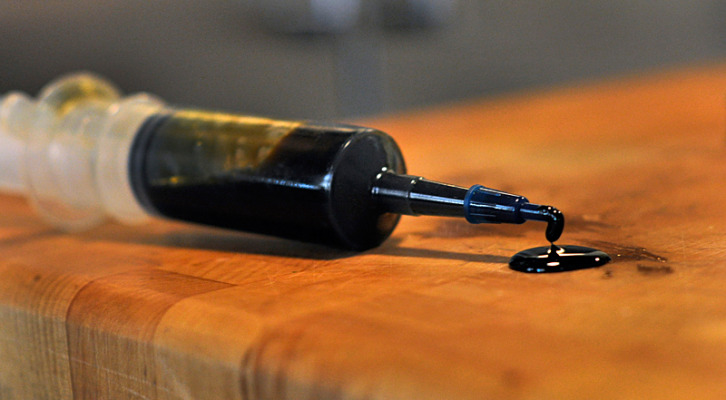 "cannabis oil in a syringe for easy dosing. This oil is also referred to as ""full extract,"" or ""rick simpson oil"" (rso). it's made with an alcohol reduction. recipes on the apothecary page."