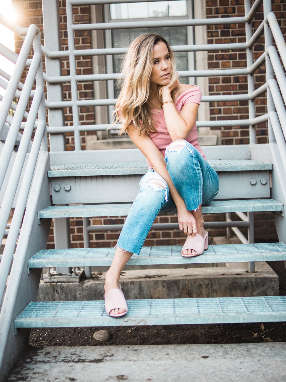 blush off the shoulder top with boyfriend jeans and pink mules