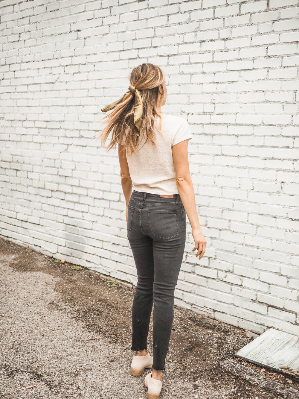 madewell black jeans and hair bow accessory
