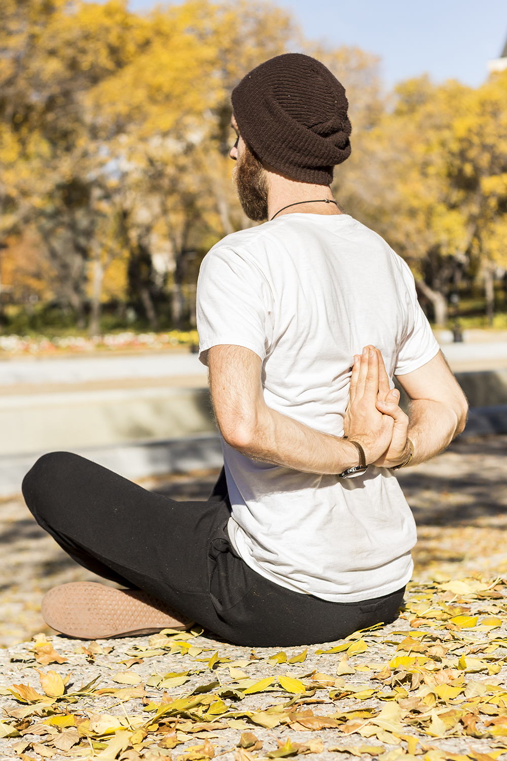 Man doing reverse prayer mudra yoga pose to soften shoulders and chest.
