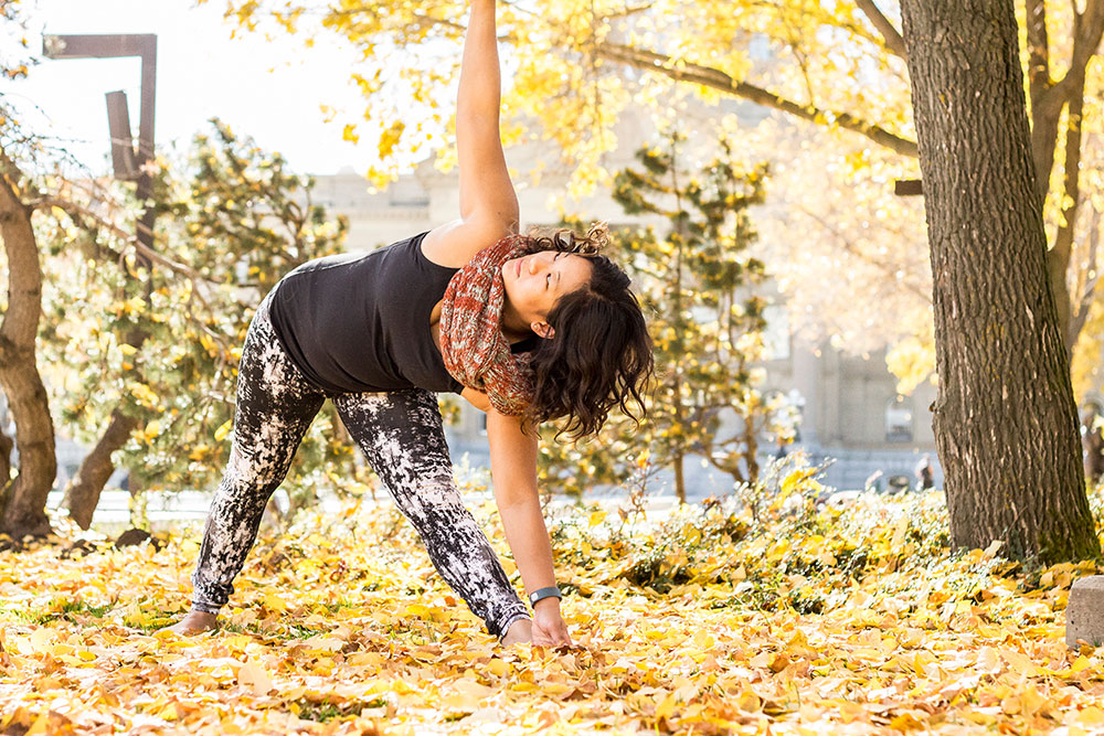 Yoga triangle pose in autumn.