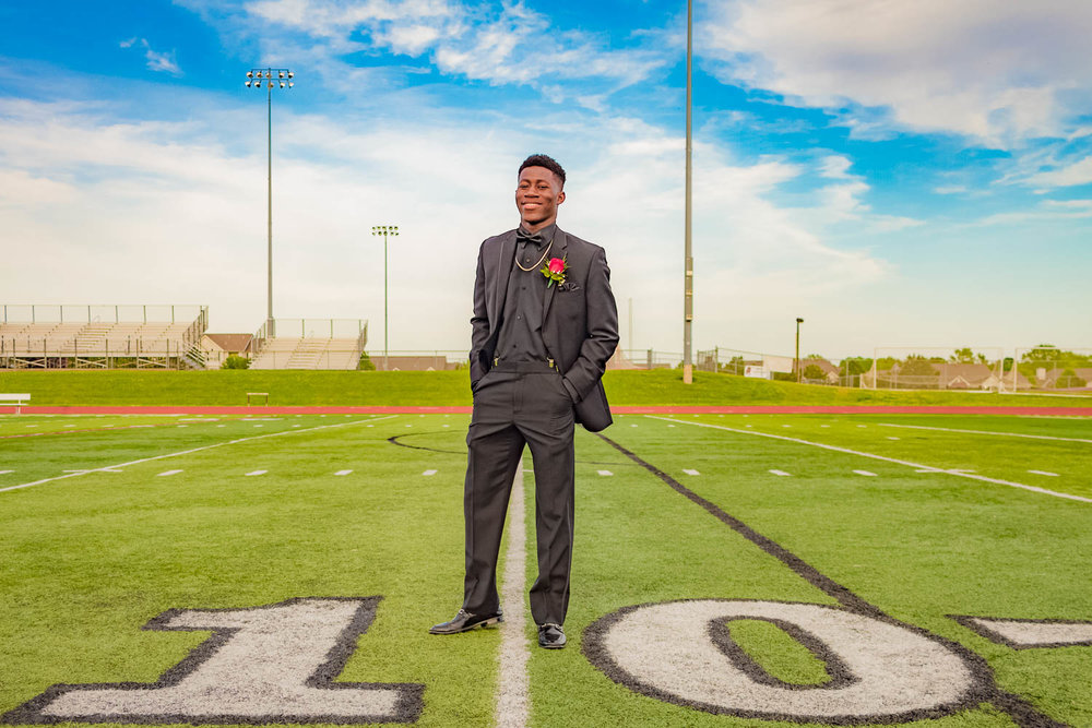 Lee's Summit North - Senior portrait of #10 on the same football field where he played.
