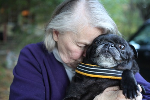 Woman and Black Pug