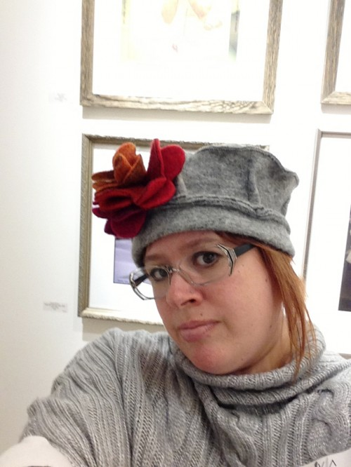Woman in Gray Hat Red Flower
