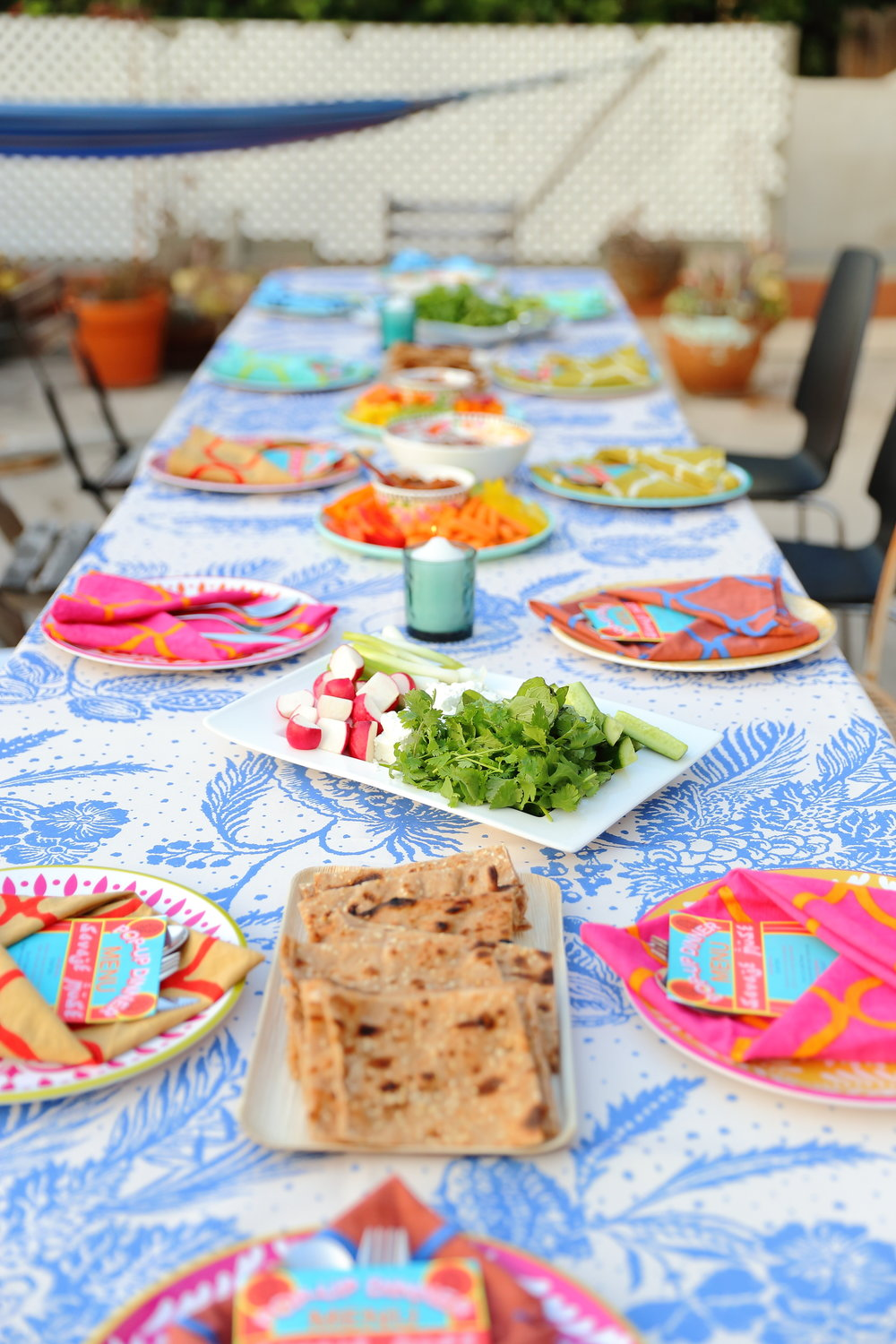 "Table setting I designed for the SAVAGE MUSE pop-up dinner series.  Pictured on the table are some of the ""mezze"" style appetizers: Naan'o'Panir (the Persian cheese and herb plate along with Sangak bread). Photo credit:   Tina June"