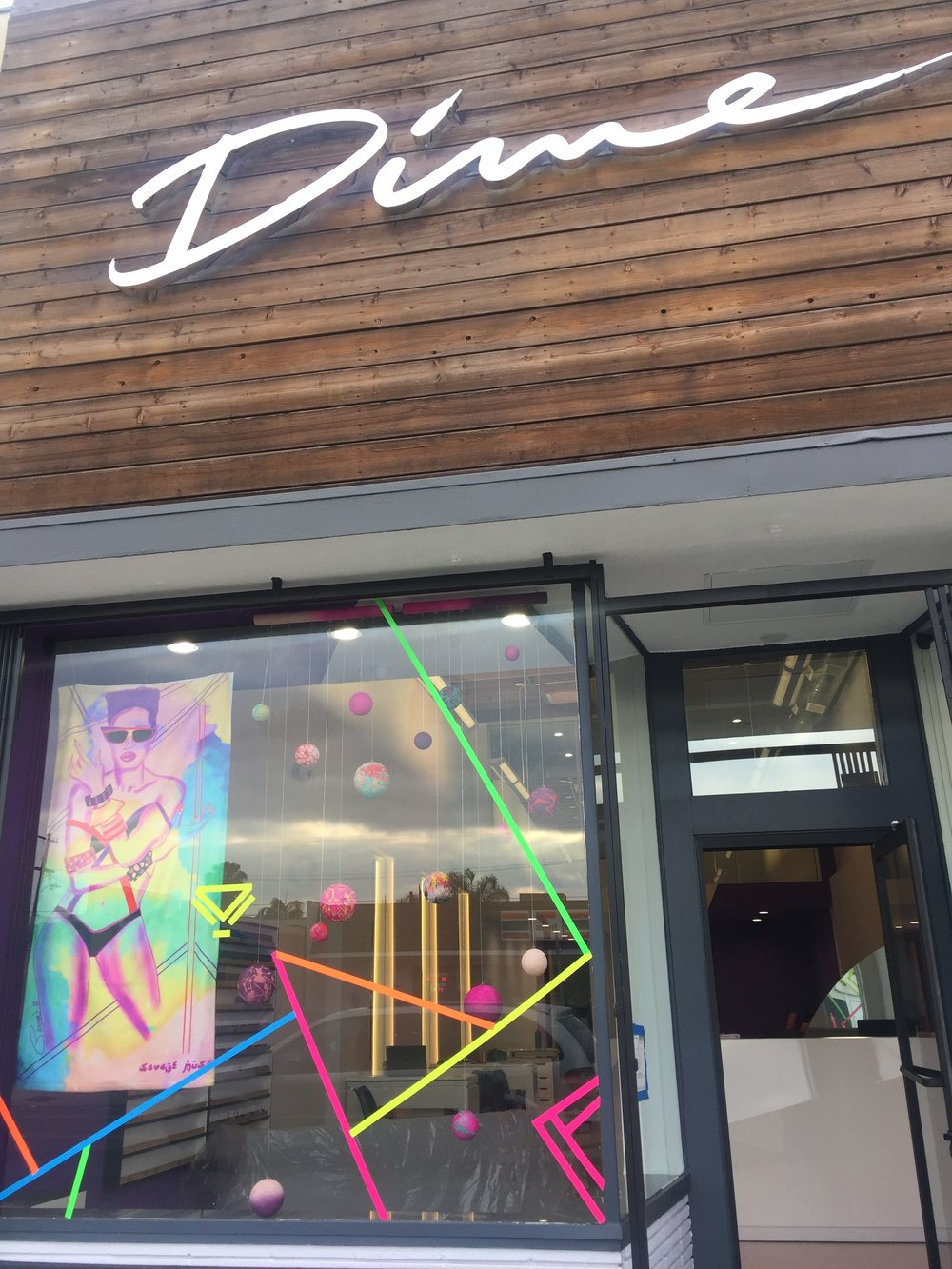 Window art installation designed by Parisa Parnian for the SAVAGE MUSE X DIME NAILS collaboration.