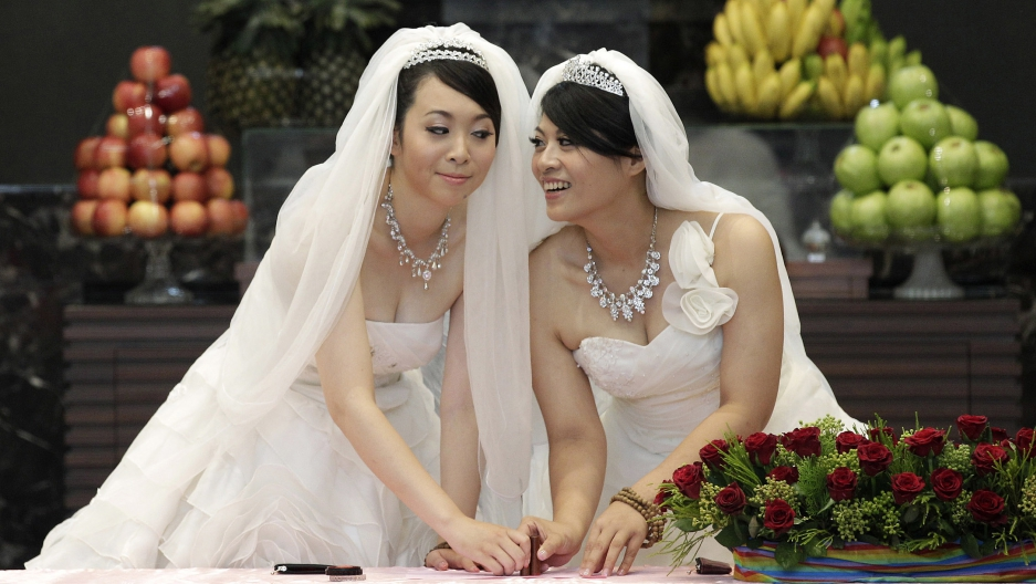 A couple gets married after the legalization of same-sex marriage in Taiwan. Source: Public Radio International