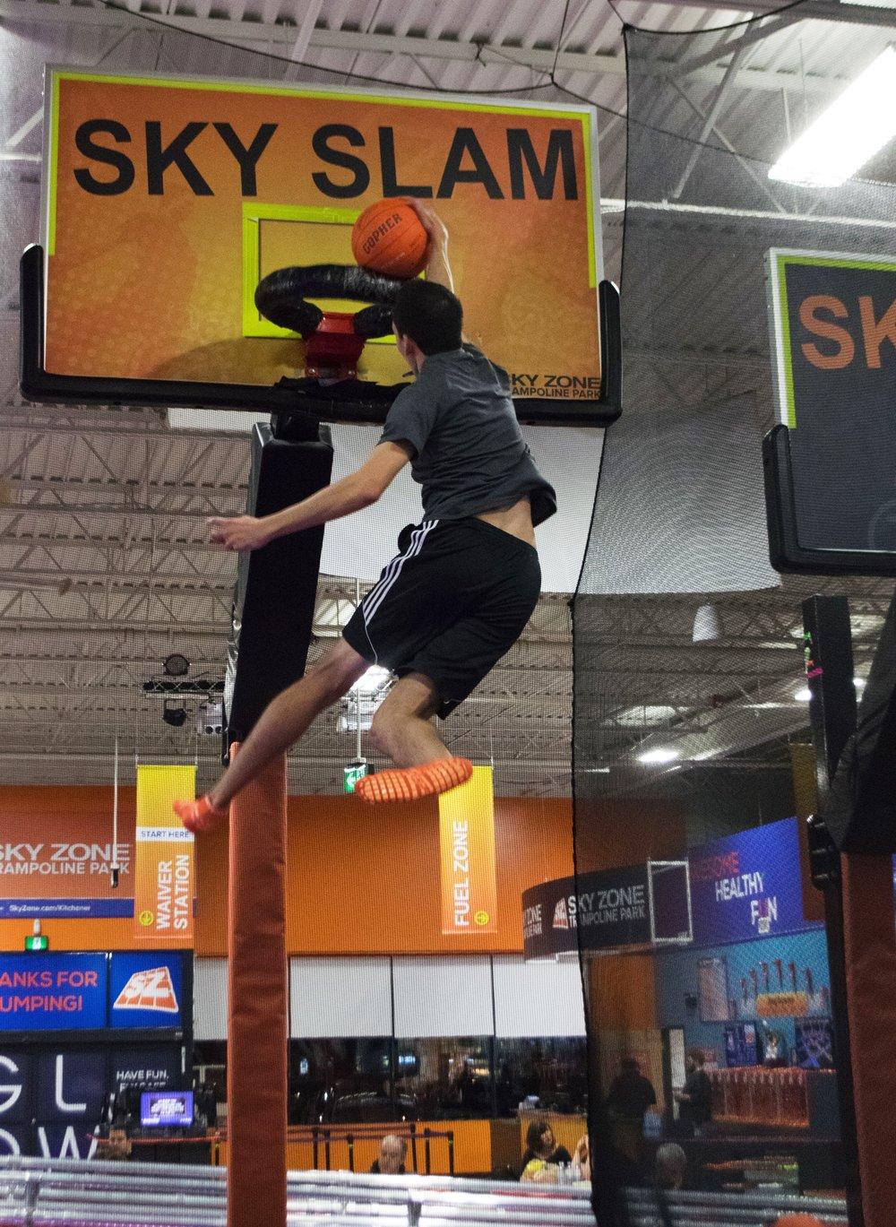 Man Dunking Basketball at Sky Zone