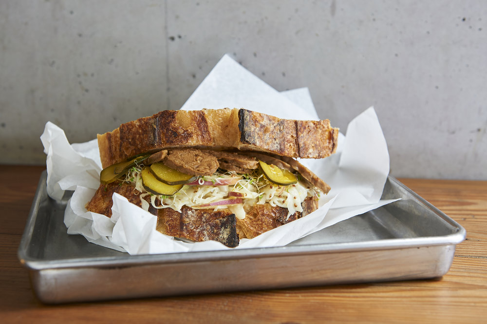 TEMPEH REUBEN   - APPLE & FENNEL SLAW<MUSTARD PICKLES<SMOKED TEMPEH<CASHEW CREAM