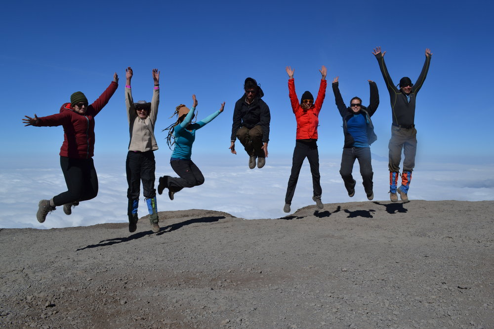 Jumping above the clouds on Mount Kilimanjaro in Tanzania