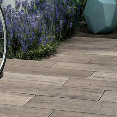 NAU   CONTEMPORARY  Nau interprets the character of reclaimed wood on a durable porcelain paver. Available in either squares or planks, Nau creates outdoor living spaces with distinctive urban flair.