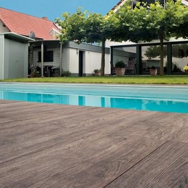 SUNDECK   CONTEMPORARY  Sundeck is an outdoor interpretation of indoor wood flooring with striations and shading that capture the essence of various wood finishes.