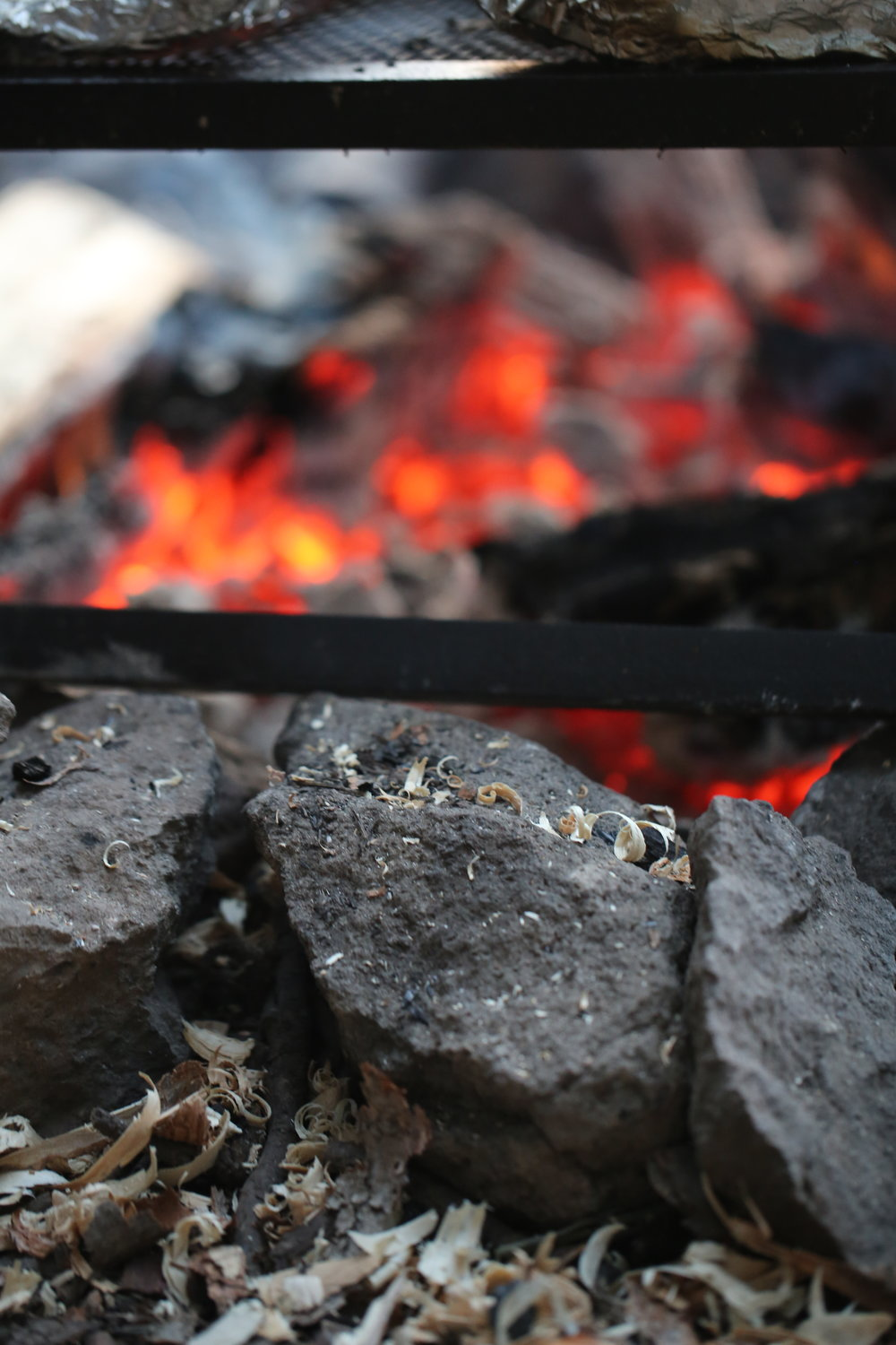its a good idea to spread coals out evenly so heat is distributed ACROSS your cooking area