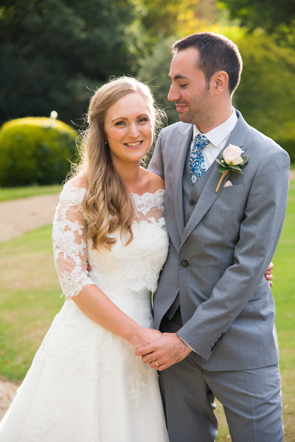 Bride and Groom hold hands Highbury hall Birmingham