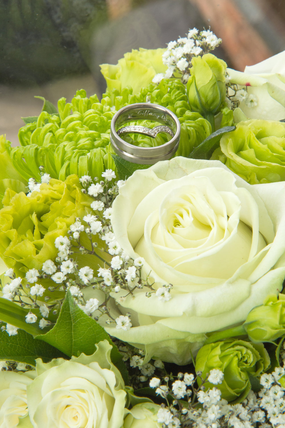 Wedding rings in green wedding bouquet Clickspeed Photography
