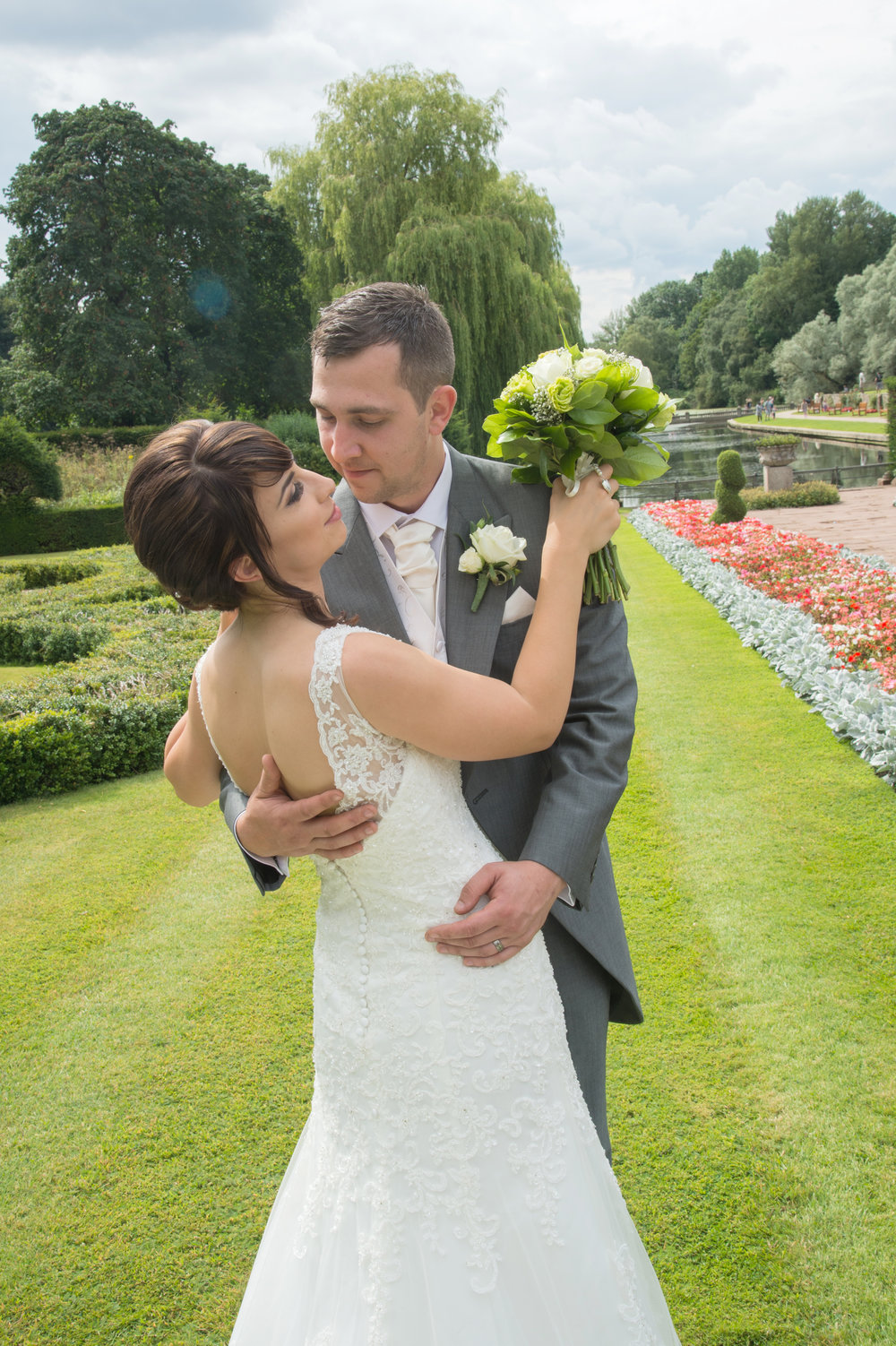 Bride and in the garden Groom Coombe Abbey Warwickshire