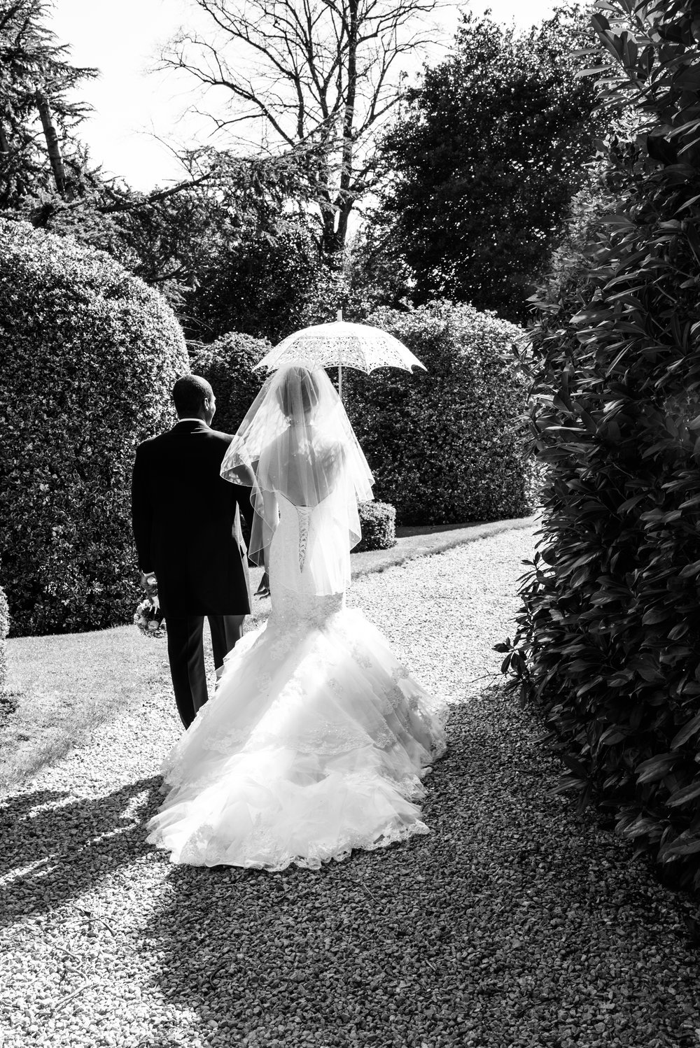 Bride and Groom with parasol Highbury Hall Birmingham West Midlands