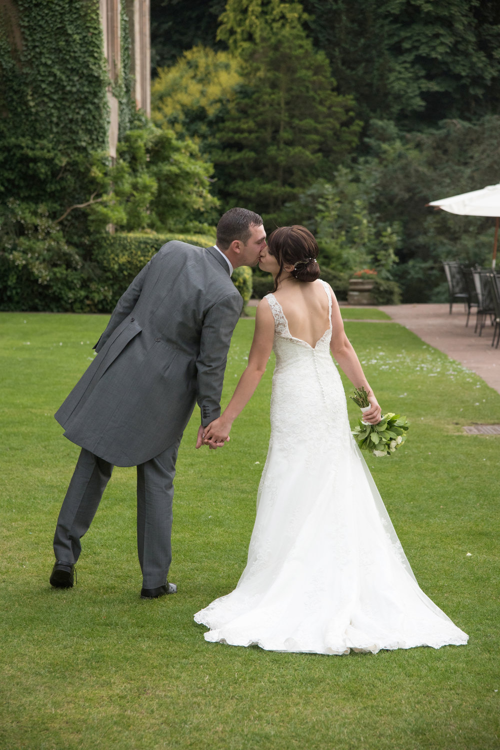 Bride and Groom Kiss on the lawn of Coombe Abbey Hotel Coventry Warwickshire