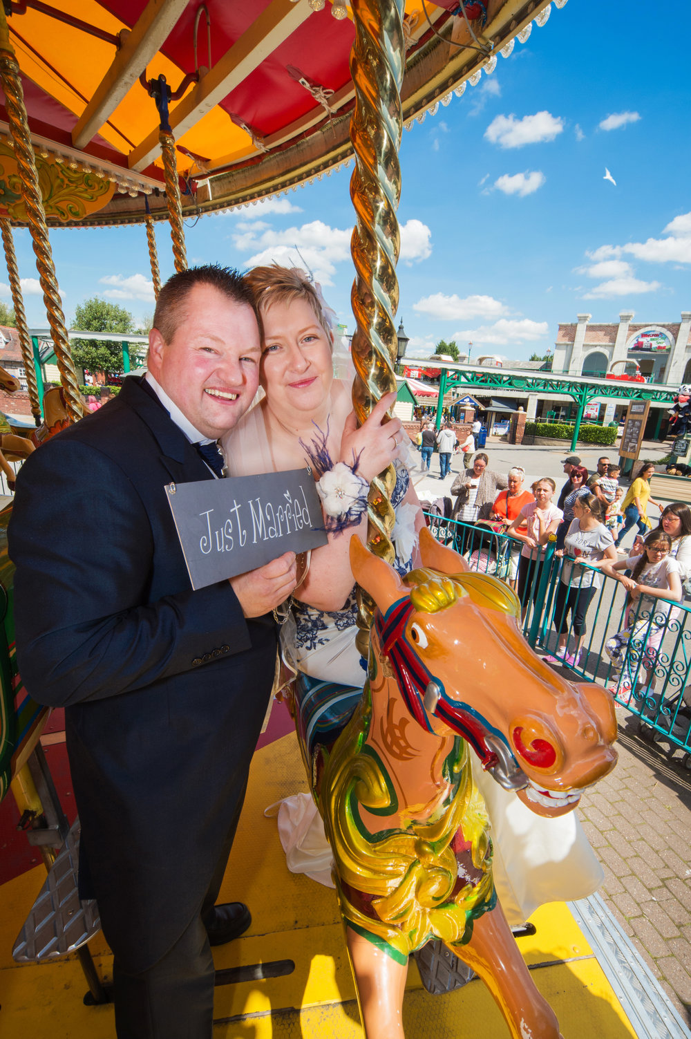 Bride and Groom on Carousel Drayton Manor Hotel Tamworth Staffordshire
