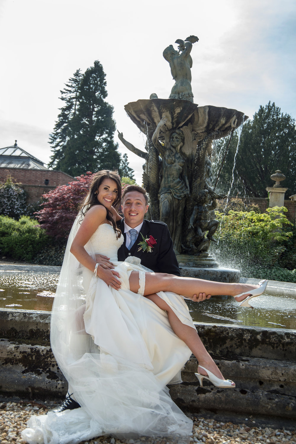 Bride and Groom by the fountain Highnam Court Gloucestershire
