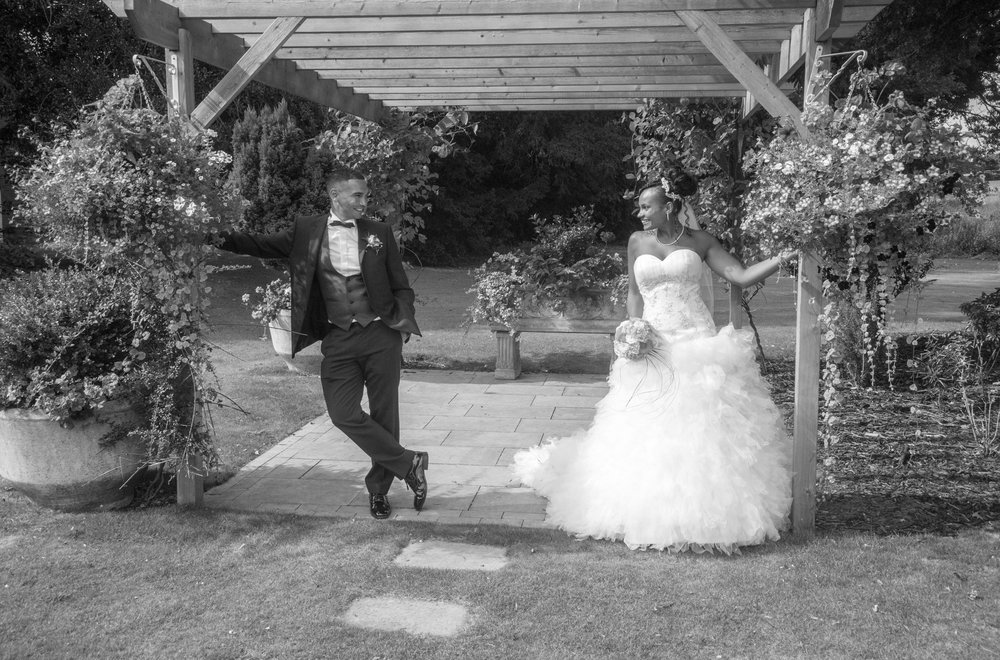 Bride and Groom under pergola Brandon Hall Hotel Coventry Warwickshire