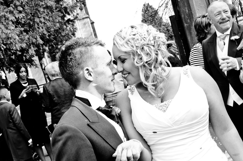 Bride and Groom kiss Holy Trinity Church Wordsley Stourbridge