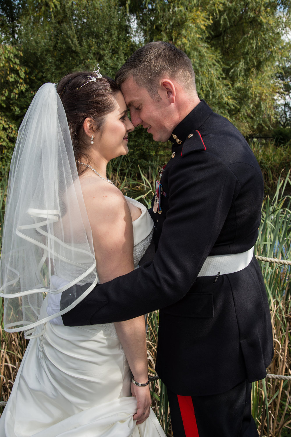 Bride and groom kiss at Avoncroft Museum Bromsgrove Worcestershire
