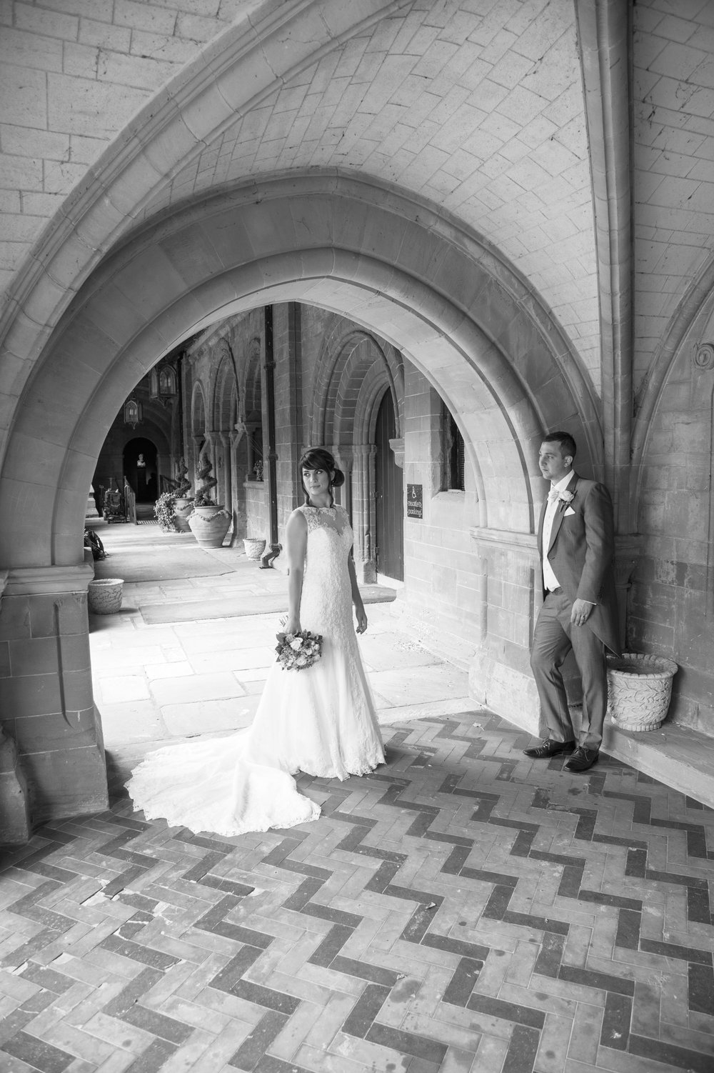 Bride and Groom under the arches Coombe Abbey Hotel Coventry Warwickshire