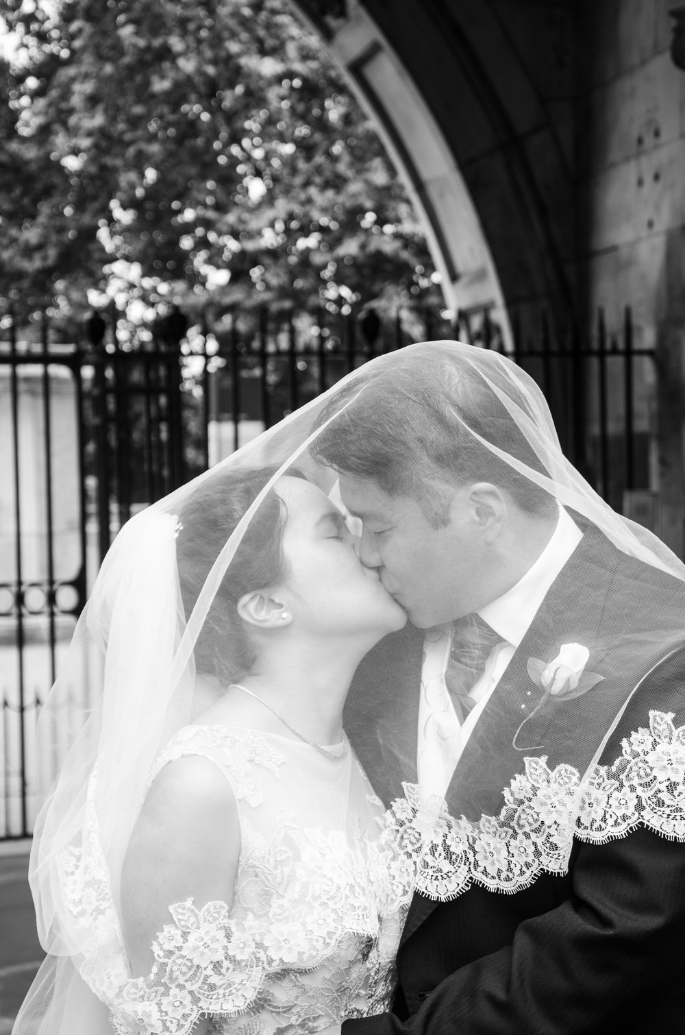 Bride and Groom kiss Kings College London