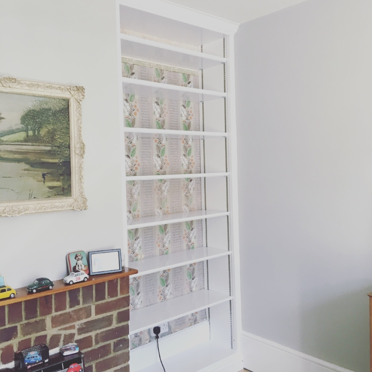 New built in shelves in my living room, with vintage wallpaper behind that came with the house