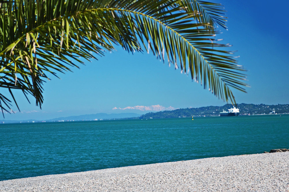 Snow-covered Caucasus Mountains - view from a beach in Batumi