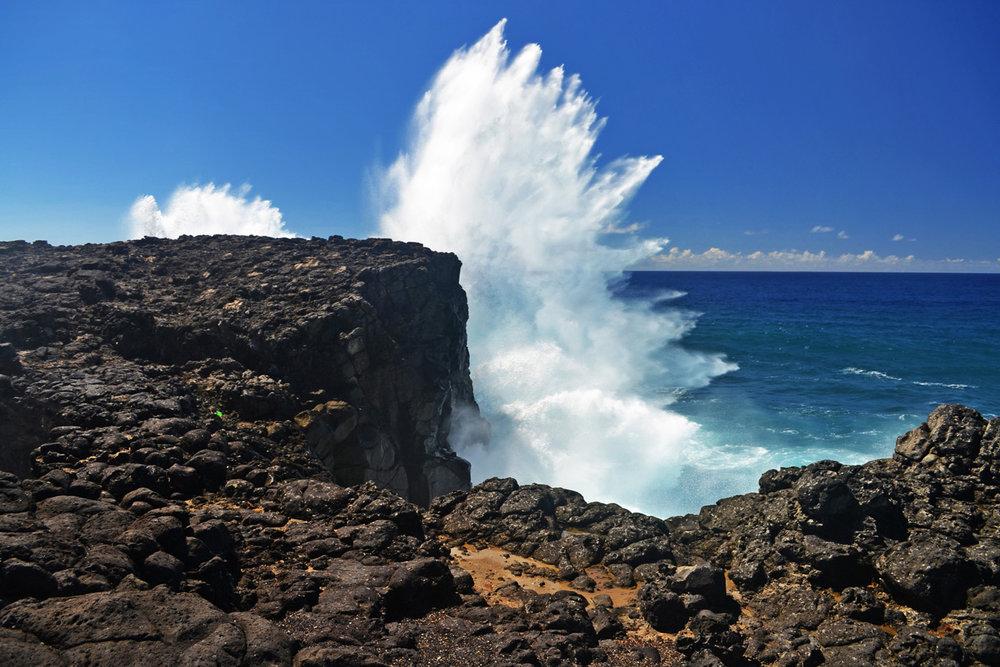 Waves crash against the cliff, Pont Naturel