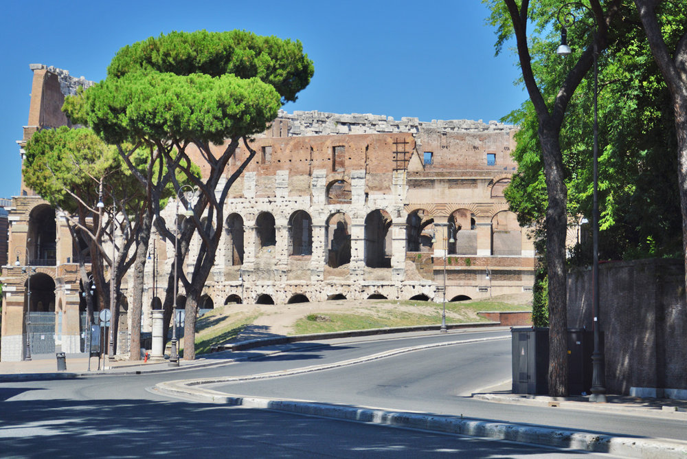 The Colosseum surrounded by modern roads