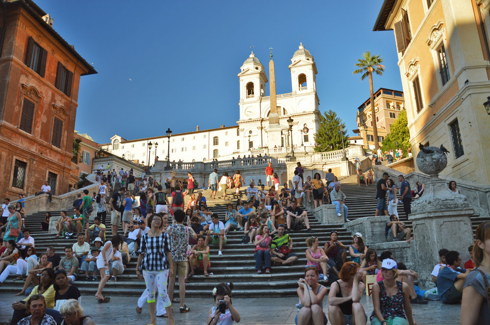 Spanish steps crowded by tourists, Trinita dei Monti church on top