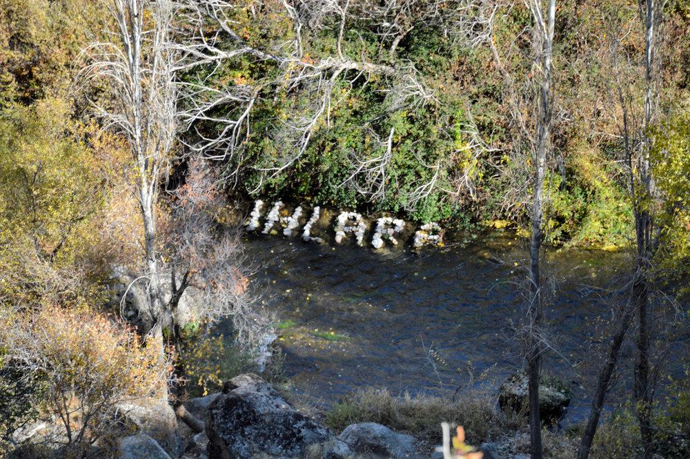 A sign made of stones in Melendiz river