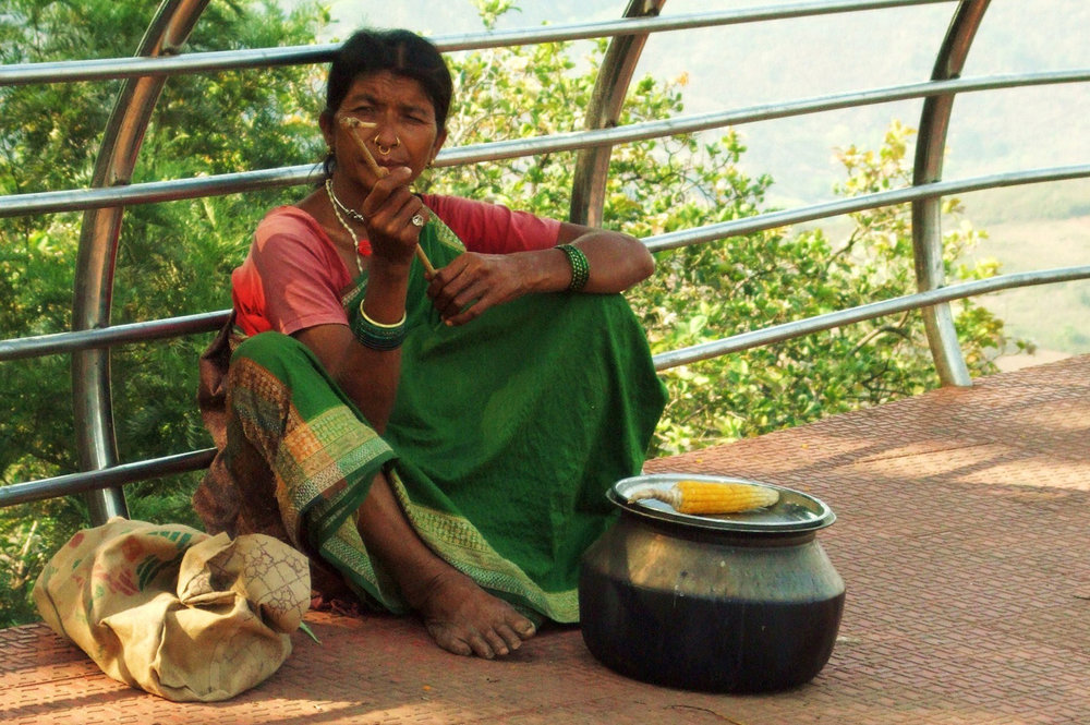 A tribal woman selling corn