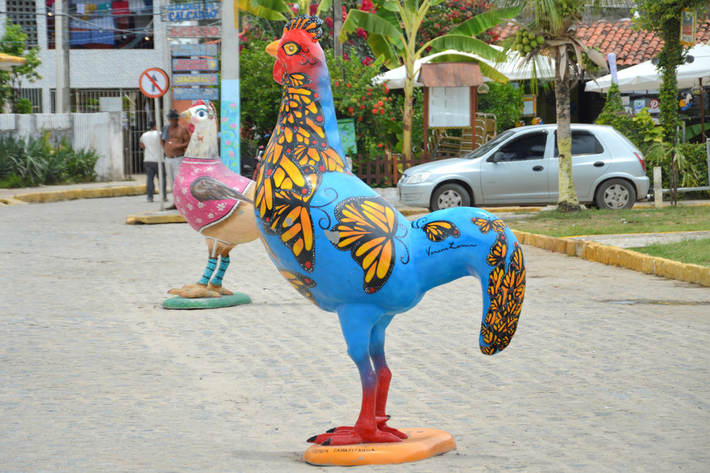 Colorful chicken statues in Porto de Galinhas