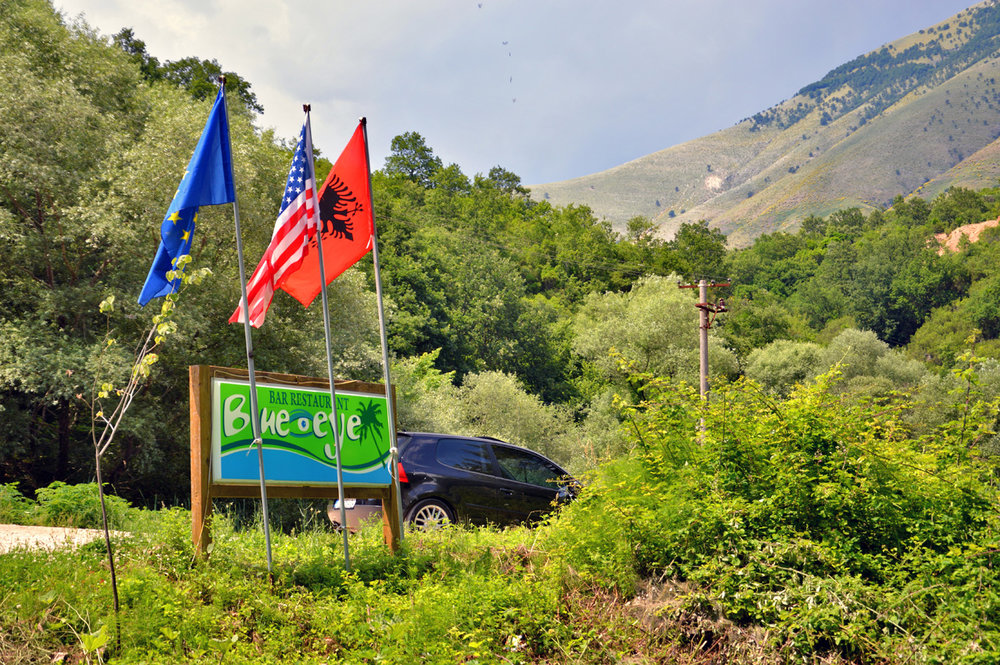 Blue Eye - at the entrance (EU and US flags can be found everywhere in Albania)
