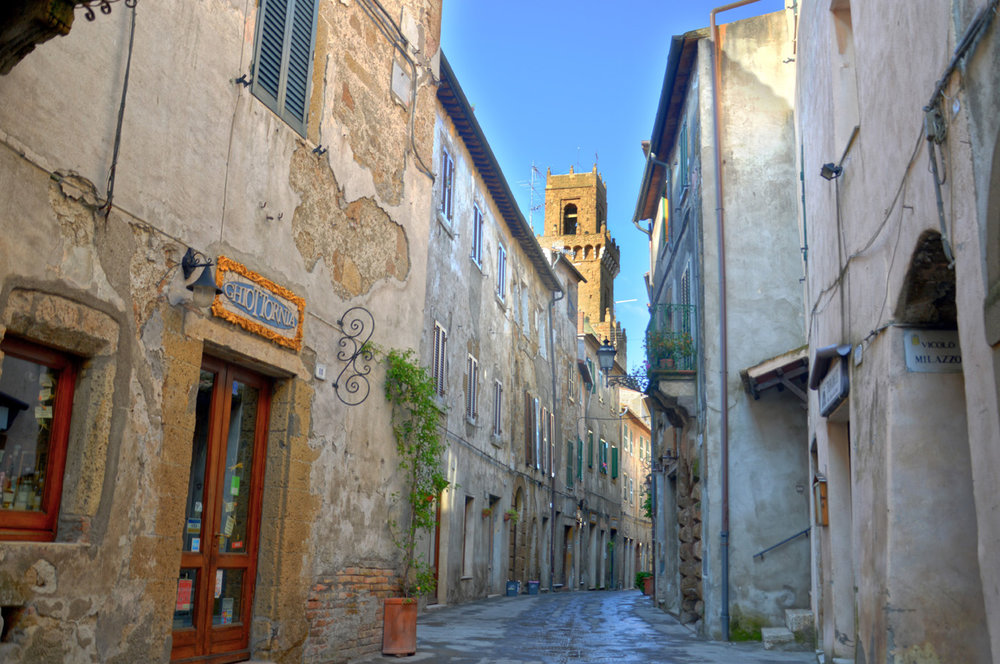 A street in Pitigliano - The cathedral tower visible in the background